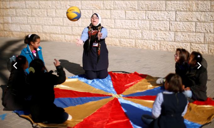 Учительница в Газе с синдромом Дауна – истинное вдохновение для своих учеников